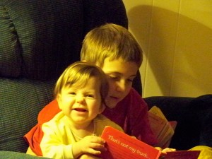 Our little lady sharing books with her big big brother, Drew!